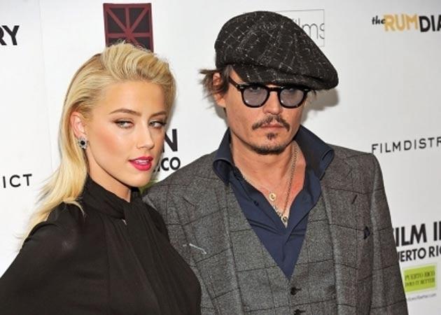 Li se întâmplă şi celor mai buni! Johnny Depp a fost părăsit de iubita bisexuală! Ea a fugit cu o femeie superbă în vacanţă!