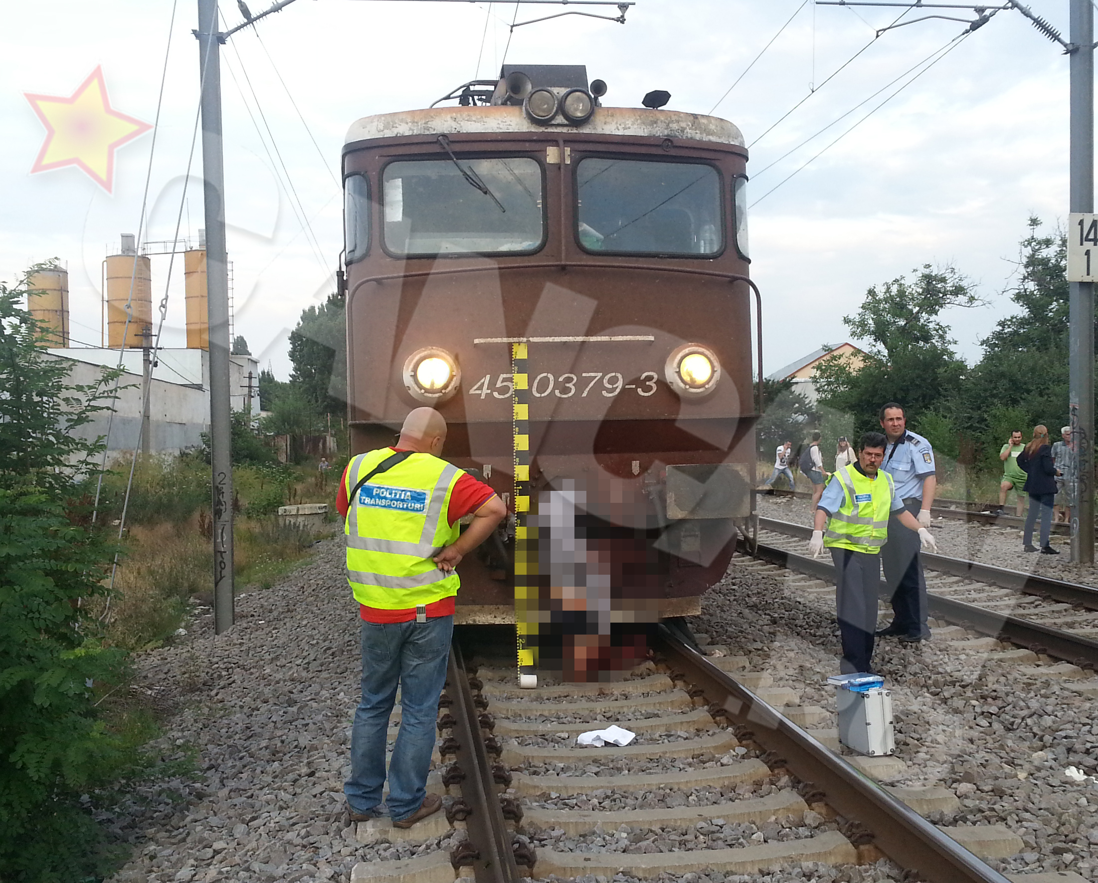 Cadavrul a ramas agatar de cuiul locomotivei