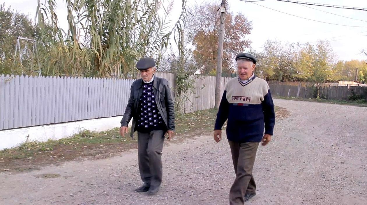 Doi dintre supravieţuitorii închisorilor comuniste, Marian Apostu şi Costică Budu
