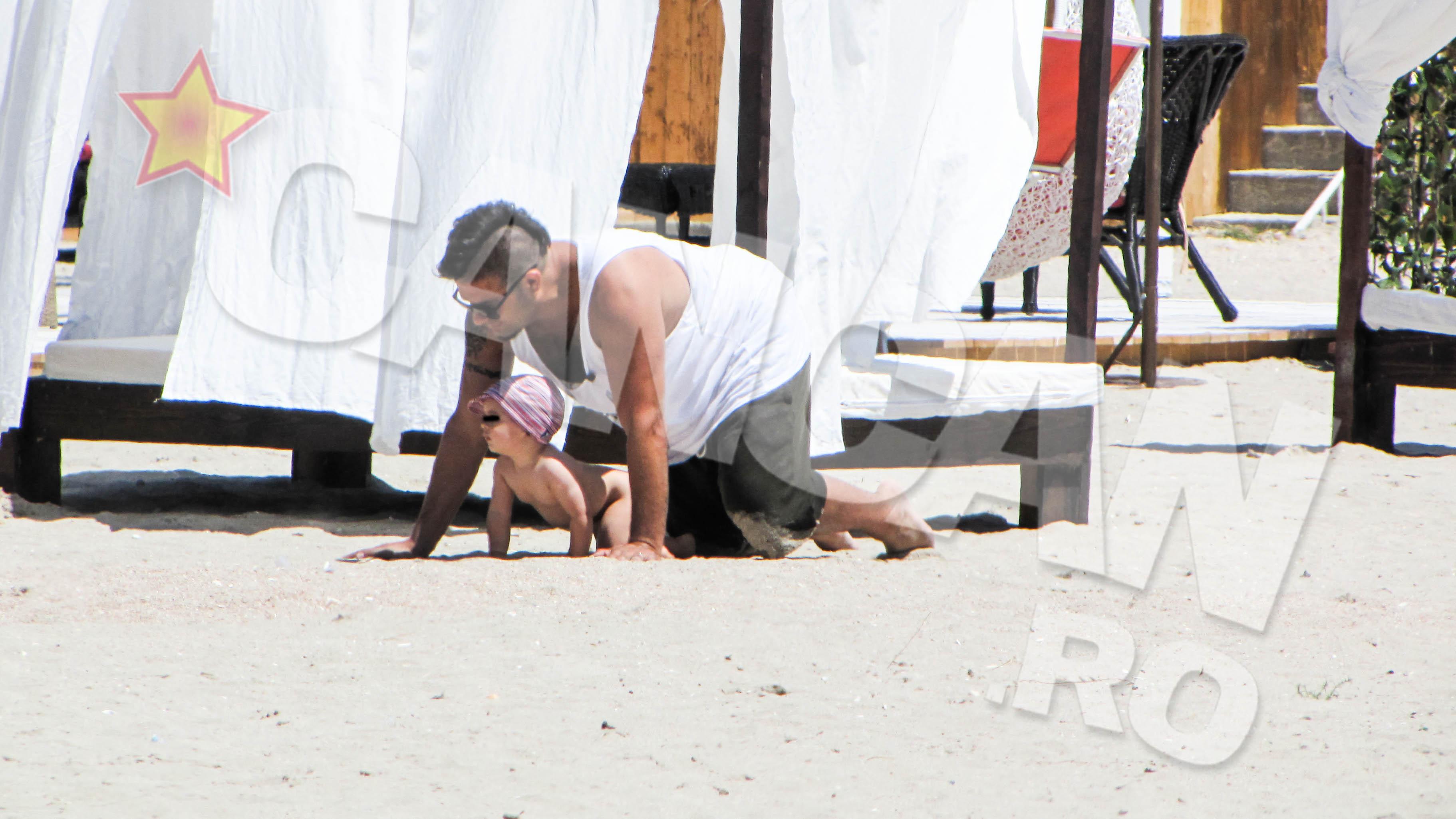 Edi Stancu s-a distrat de minune pe plaja in compania fiului sau