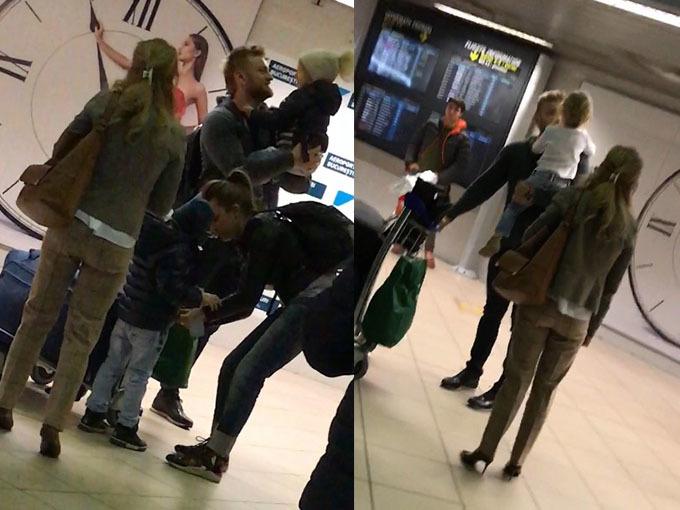 Florin Staicu şi soţia lui şi-au luat copiii în braţe, fiind fericiti că s-au întors din călătorie.